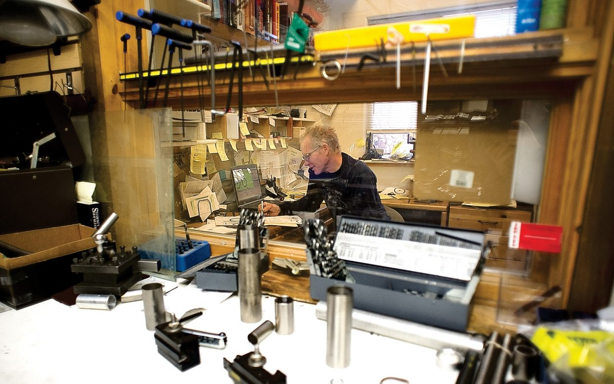 JKent Eriksen, owner and founder of Eriksen Cycles, talks with a customer on the phone inside the downtown Steamboat Springs bike manufacturing shop. Eriksen, who has been building bikes for more than 30 years, continues to produce top-end road and mountain bikes in Steamboat.