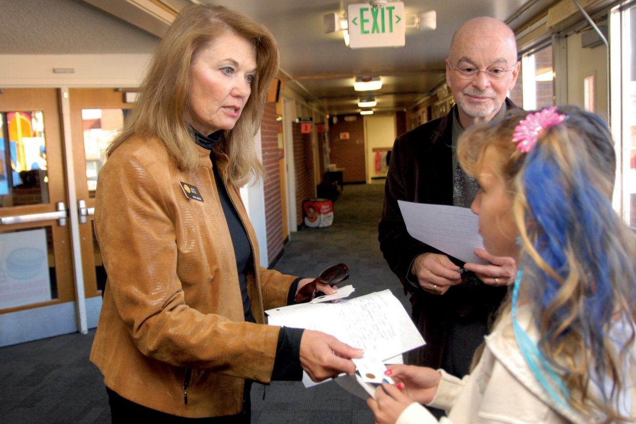 Colorado Sen. Jean White, left, R-Hayden, gives her card to Kinlie Brennise during her visit to Moffat County School District schools in October 2011 as Superintendent Joe Petrone looks on. Kinlie helped give White a tour of the school and showed an interest in the political process, said White, who nominated Kinlie to participate in the second annual Girls With Goals Day.