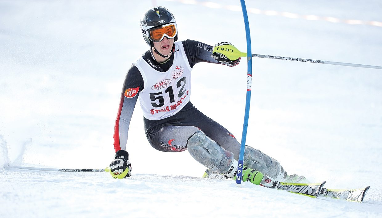 Steamboat Springs skier Connor Bernard pushes a gate out of the way while making his way down the slalom course at Howelsen Hill during Friday's high school race. Bernard won the men's race, and teammate Suzanne Lyon topped the women's field in the race hosted by Steamboat Springs High School.