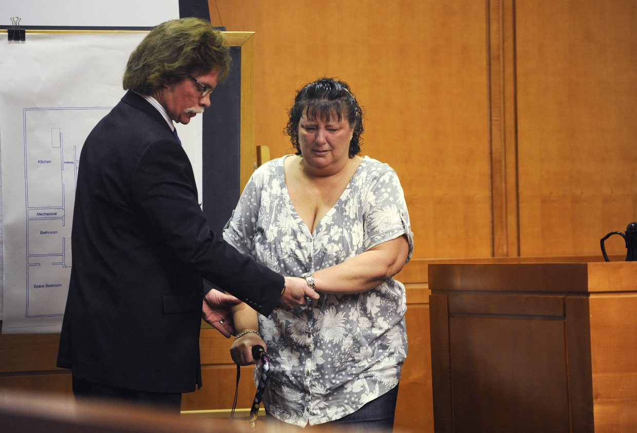 Rhonda Heaton is helped off the witness stand Friday by Routt County Chief Deputy District Attorney Rusty Prindle. Heaton testified about the June 2010 incident where she was shot by her former husband, Robert Cash, who is accused of attempted first-degree murder.