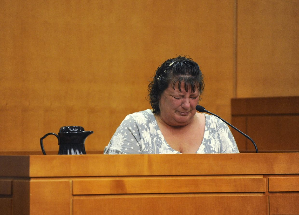 Rhonda Heaton testifies Friday about the June 2010 incident where she was shot by her former husband, Robert Cash, who is accused of attempted first-degree murder.