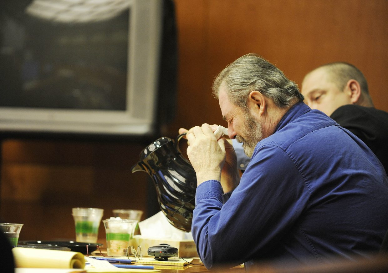 Robert Cash reacts to testimony from his former wife on Friday.