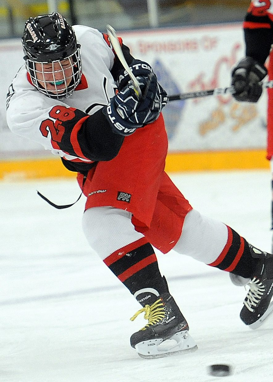 Michael Samuelson puts all he has into a third-period shot Friday against Aspen.