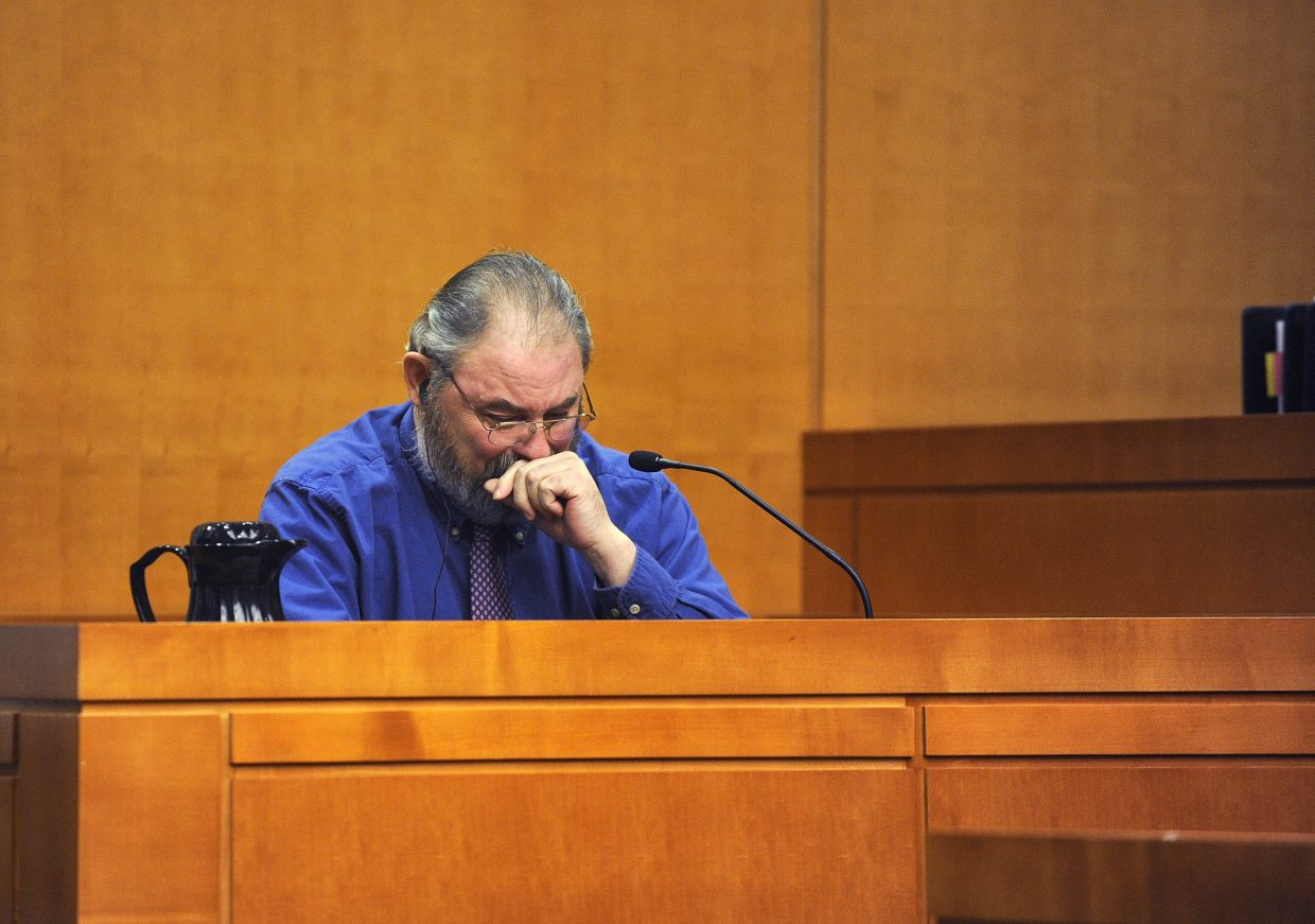 Robert Cash reacts Tuesday while testifying at the Routt County Justice Center.