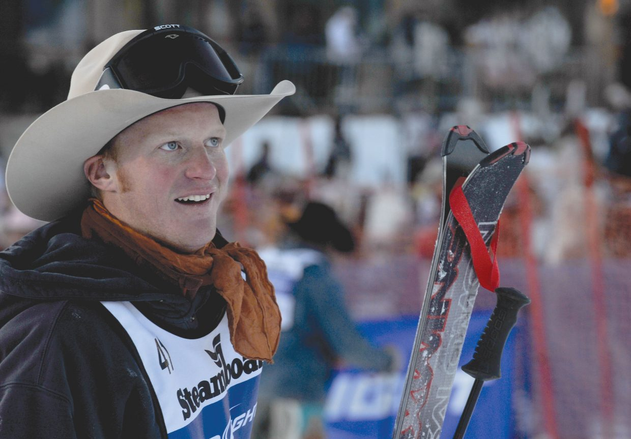 Wyoming cowboy Kyle Weides looks up the slopes of Steamboat Ski Area on Tuesday afternoon after competing in the stampede at the 38th Annual Cowboy Downhill. Cowboys from the National Western Stock Show & Rodeo visit Steamboat Springs for the race, where cowboys must ski around gates, ski over a 5-foot jump, rope a cowgirl and saddle a horse. This year's winners included Blake Knowles, who won the stampede, and Dakota Eldridge, who took top honors in the timed slalom event.