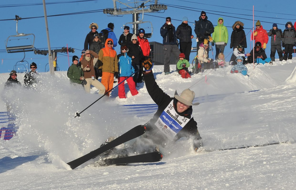 South Dakota cowboy Troy Crowser hits the snow during the 38th Annual Bud Light Cowboy Downhill on Tuesday at Steamboat Ski Area. Cowboys from the National Western Stock Show & Rodeo visit Steamboat Springs for the race every January. This year's winners included Blake Knowles who won the stampede and Dakota Eldridge who took top honors in the timed slalom event.