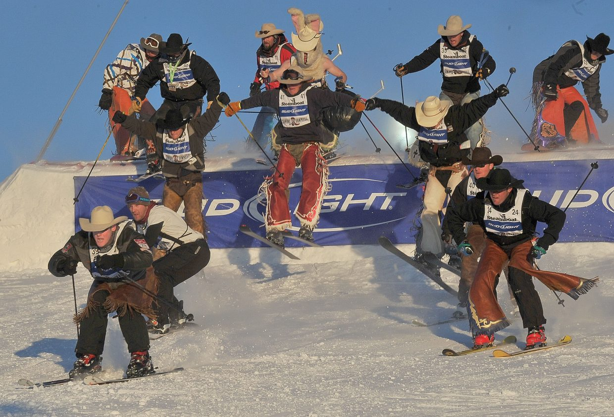 Calf roper Blake Knowles, of Heppner, Ore., leads the pack during the stampede event of the 38th Annual Bud Light Cowboy Downhill on Tuesday at Steamboat Ski Area. Cowboys from the National Western Stock Show & Rodeo visit Steamboat Springs for the race every January. This year's winners included Blake Knowles who won the stampede and Dakota Eldridge who took top honors in the timed slalom event.