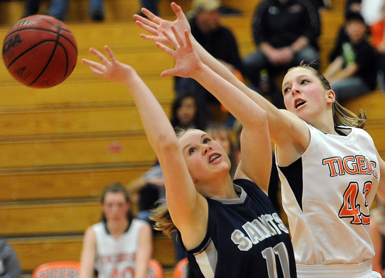 Hayden's Savannah Williams and Vail Christian's Amie Hixon reach for a rebound Saturday.