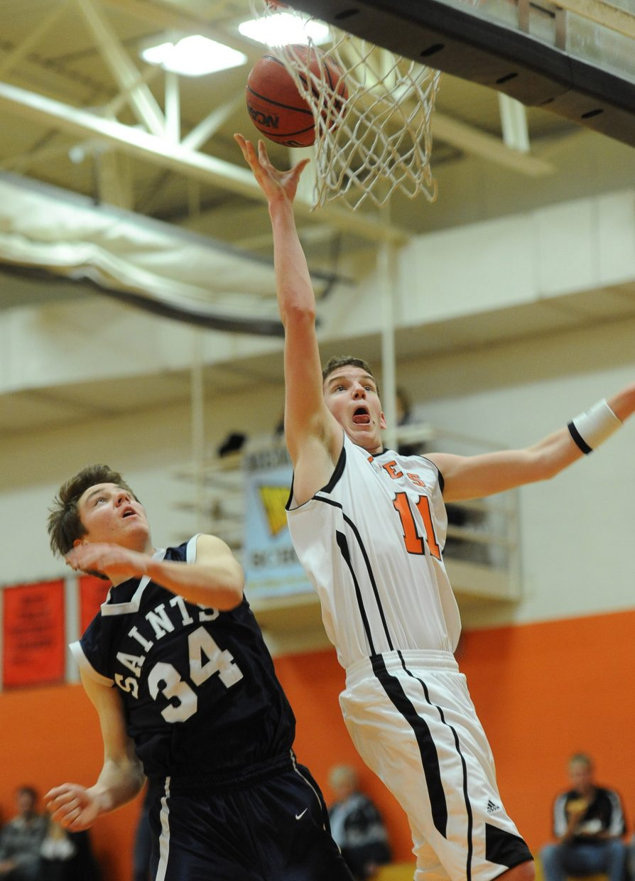 Hayden's Aaron Cramer lays in a shot Saturday against Vail Christian.