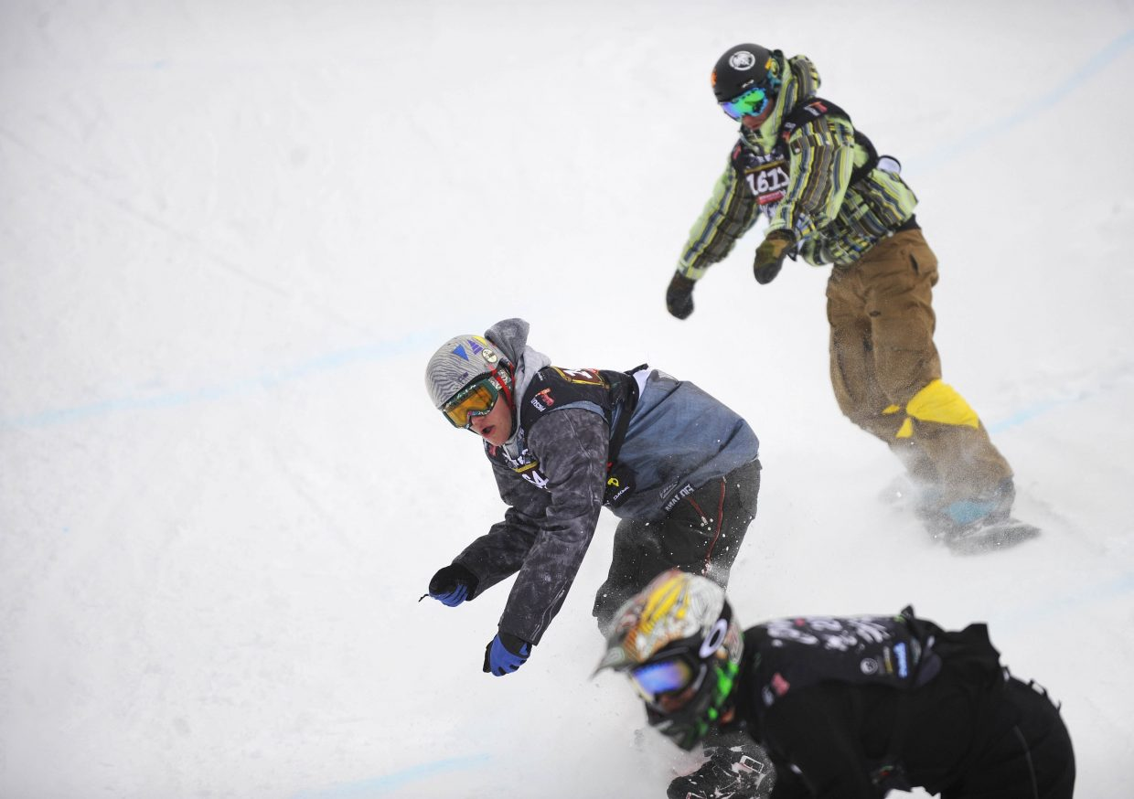 Alexander Cerny, of Alaska, competes in Saturday's snowboard cross event at Steamboat Ski Area.