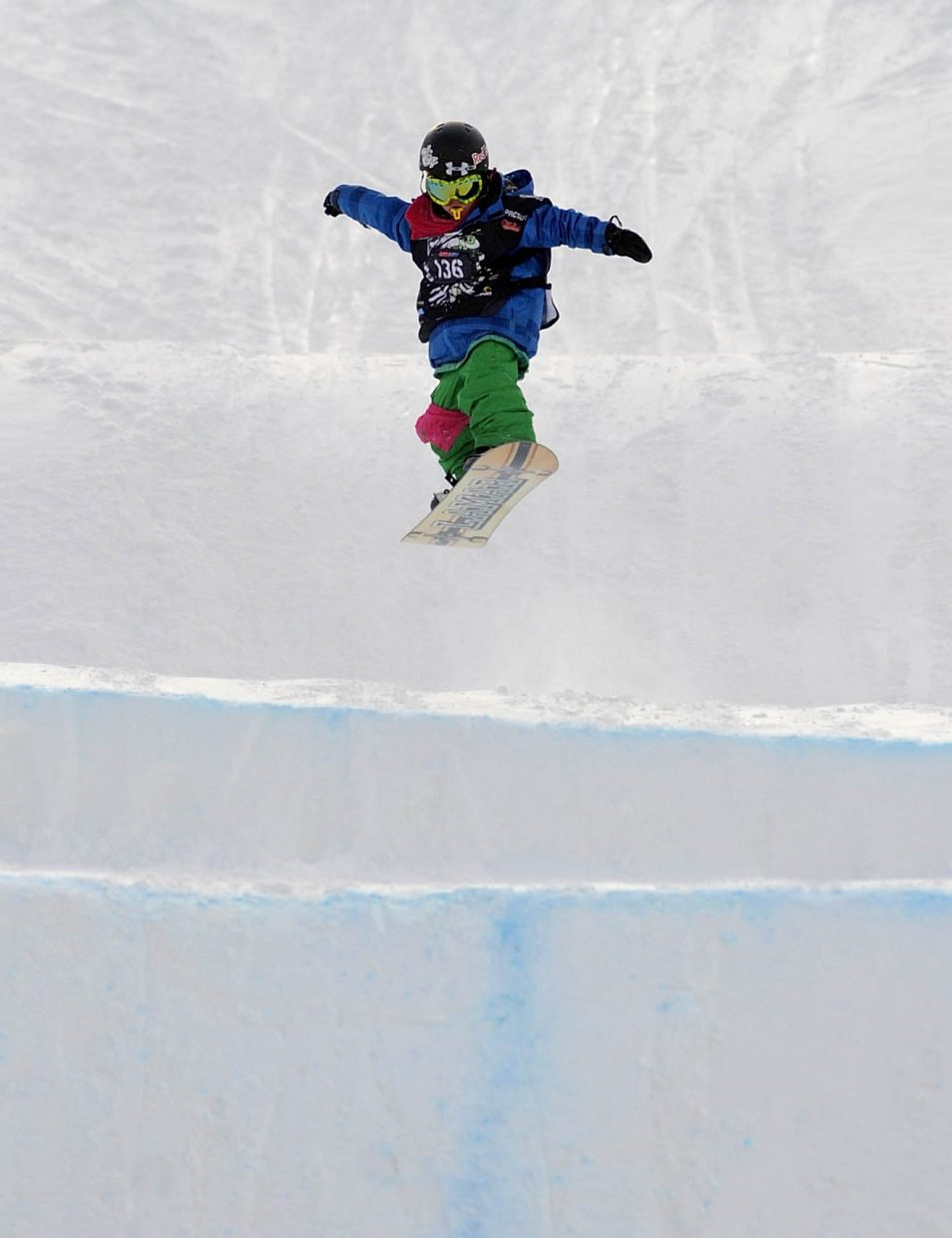 Jack Coyne, 9, of Edwards, gets air while competing in the Saturday's snowboard cross event at Steamboat Ski Area.