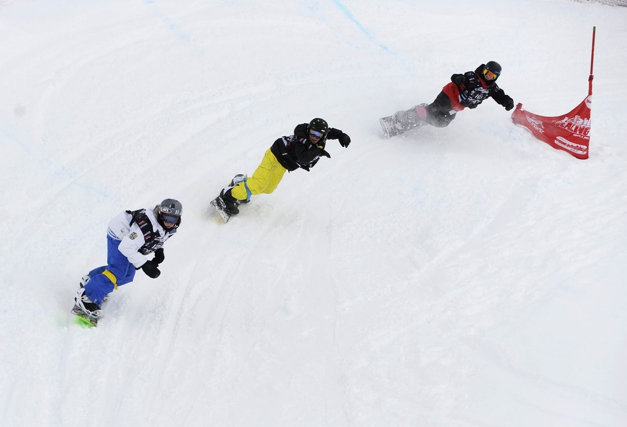 Snowboarders compete in the Saturday's snowboard cross event.
