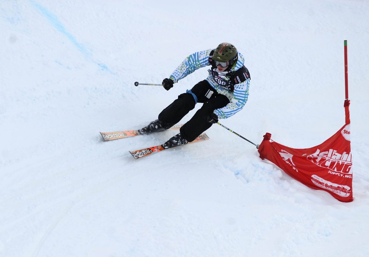 A skier rounds a gate during Saturday's ski cross event at Steamboat Ski Area.