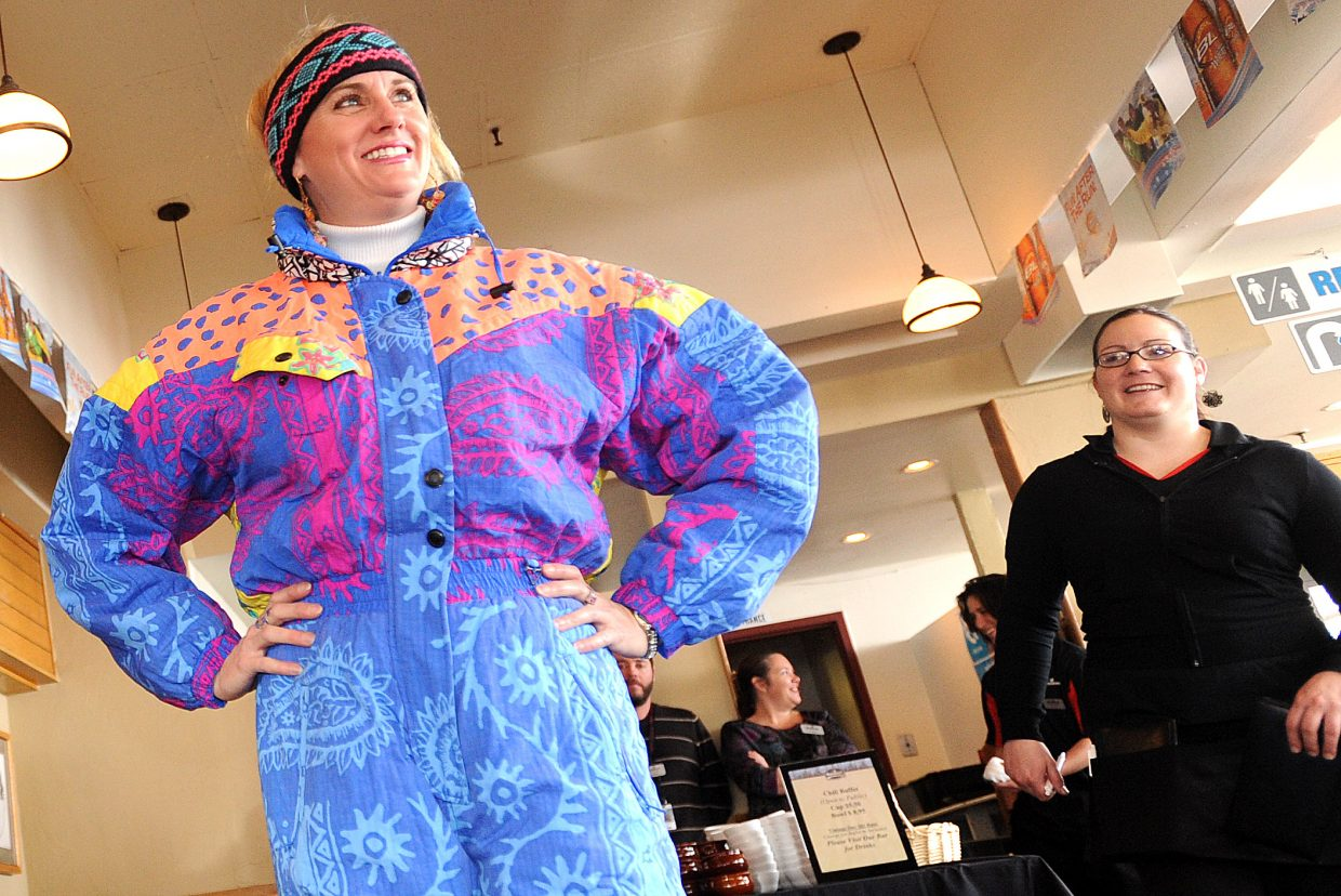 Rebecca Musso strikes a pose during hte vintage ski gear show at Bear River Bar and Grill at Steamboat Ski Area.