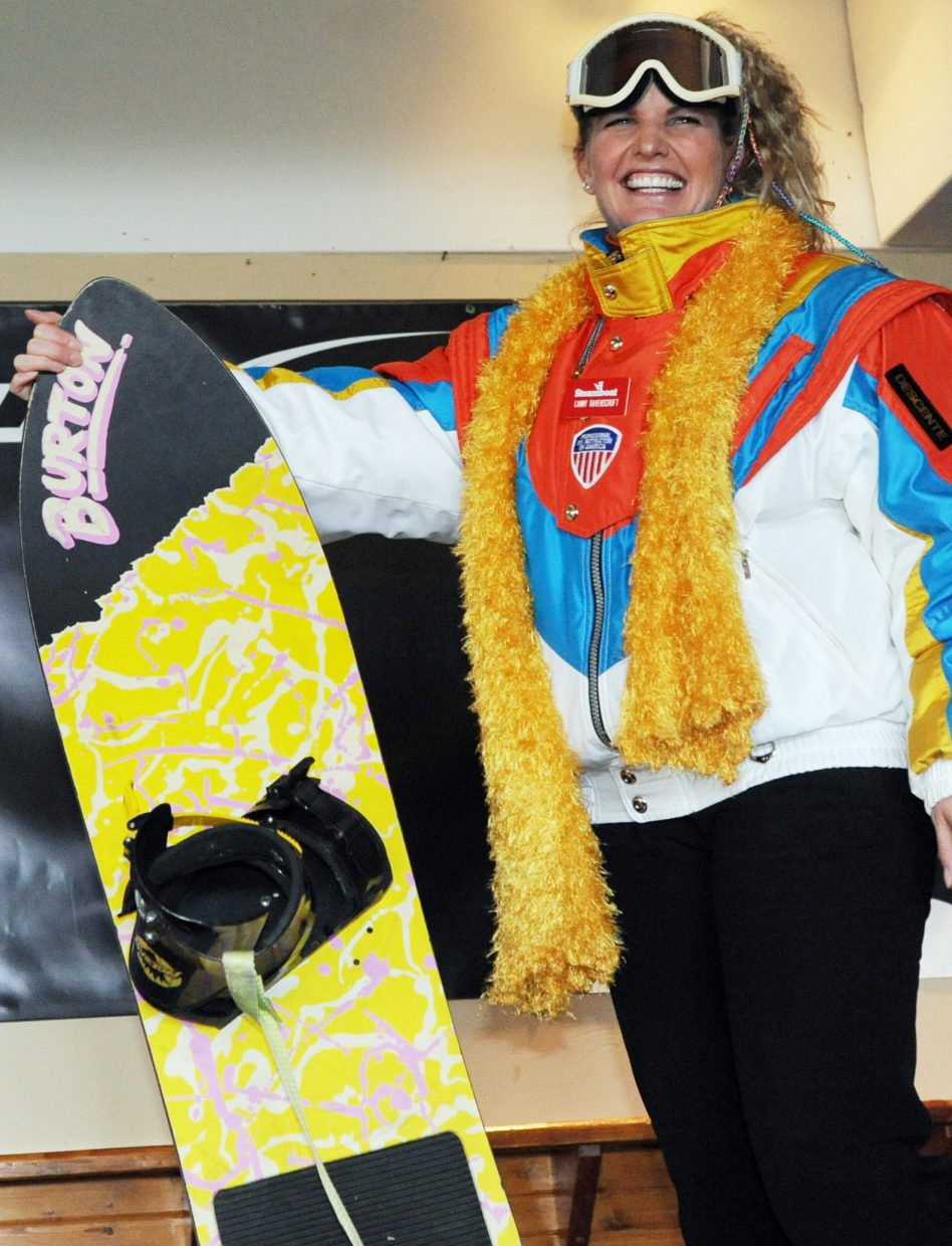 Cammy Ravenscroft shows off her vintage snowboard and gear Sunday.