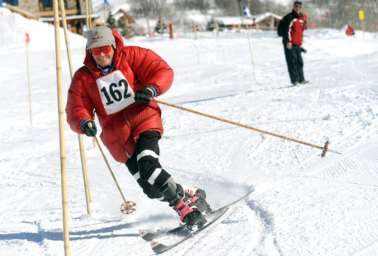 North Routt County resident Ray Heid skis Sunday in a vintage ski race at Steamboat Ski Area while wearing the red jacket he wore on a 1960 cover of Ski magazine.