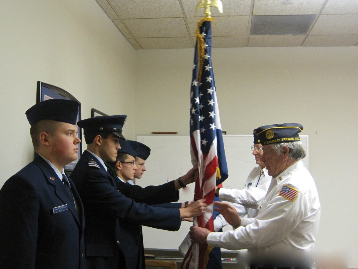 Civil Air Patrol Steamboat Springs Composite Squadron cadets, from left,are Cadet Senior Airman Joshua Heald, Cadet Second Lieutenant Noah Gibbs, Cadet Senior Master Sergeant Aidan Gibbs and Cadet Airman First Class Anthony Sisto. Presenting the American flag is American Legion Post No. 44 Commander Buck Buckland, and presenting the Colorado flag is American Legion Honor Guard Member Van Fletcher.