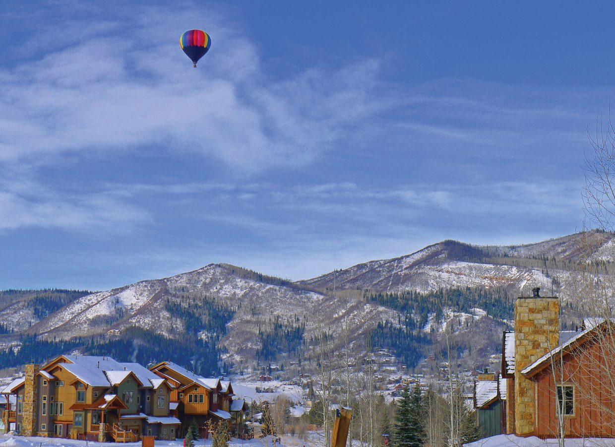 A hot air balloon floats overhead in Steamboat Springs.