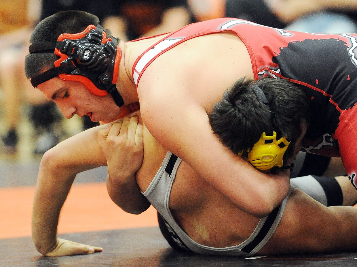 Steamboat's Cole Sittig presses to pin his Meeker opponent Thursday in Hayden.