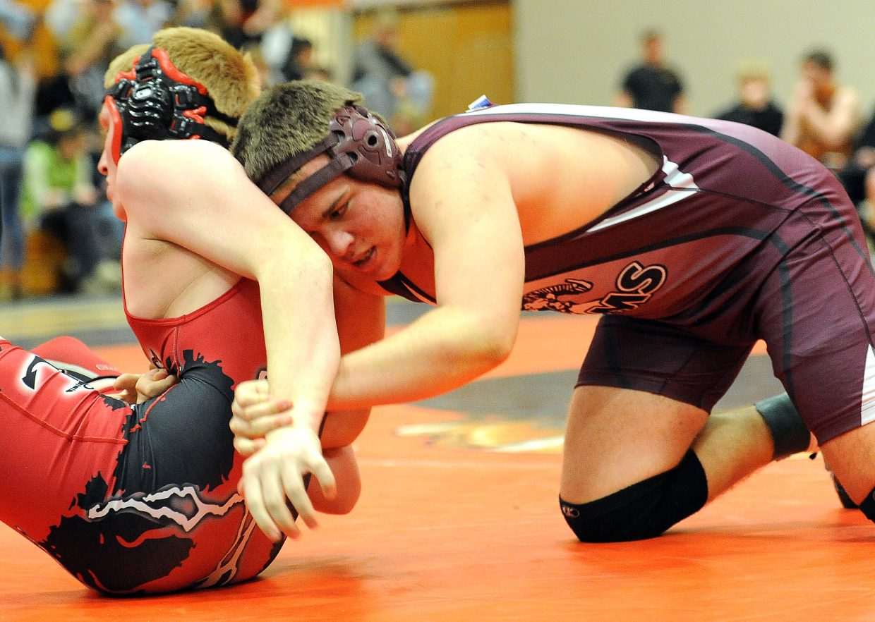 Soroco's Cody Constine tries to wrap up Steamboat wrestler Brandon Yeager. He had some success at first, but Yeager won the match, pinning Constine after 68 seconds.