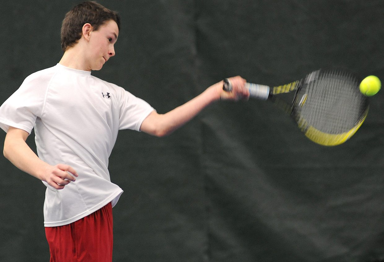 Drew Williamson plays on Sunday in the City Mixed Double and Juniors Championships at the Tennis Center in Steamboat Springs.