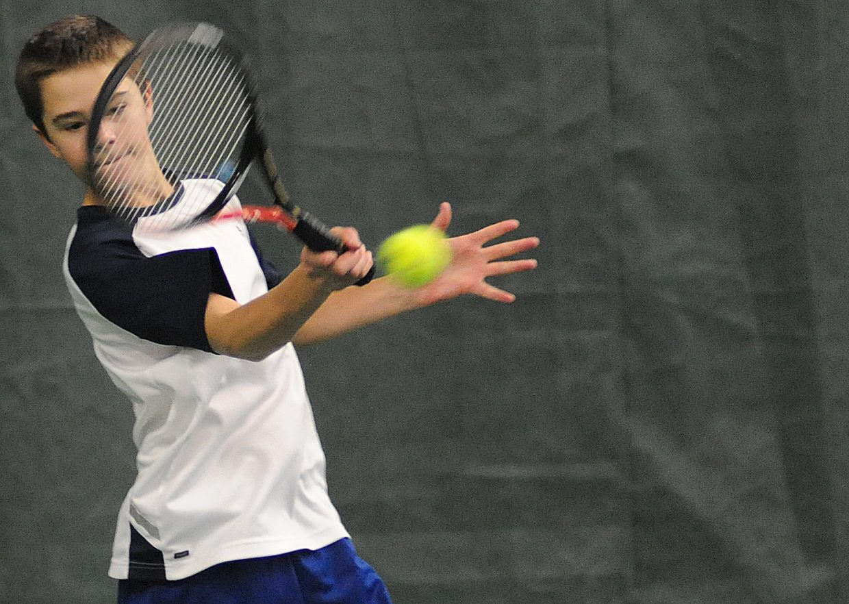 Corbin Diehl returns a ball on Sunday at the Tennis Center in Steamboat Springs.