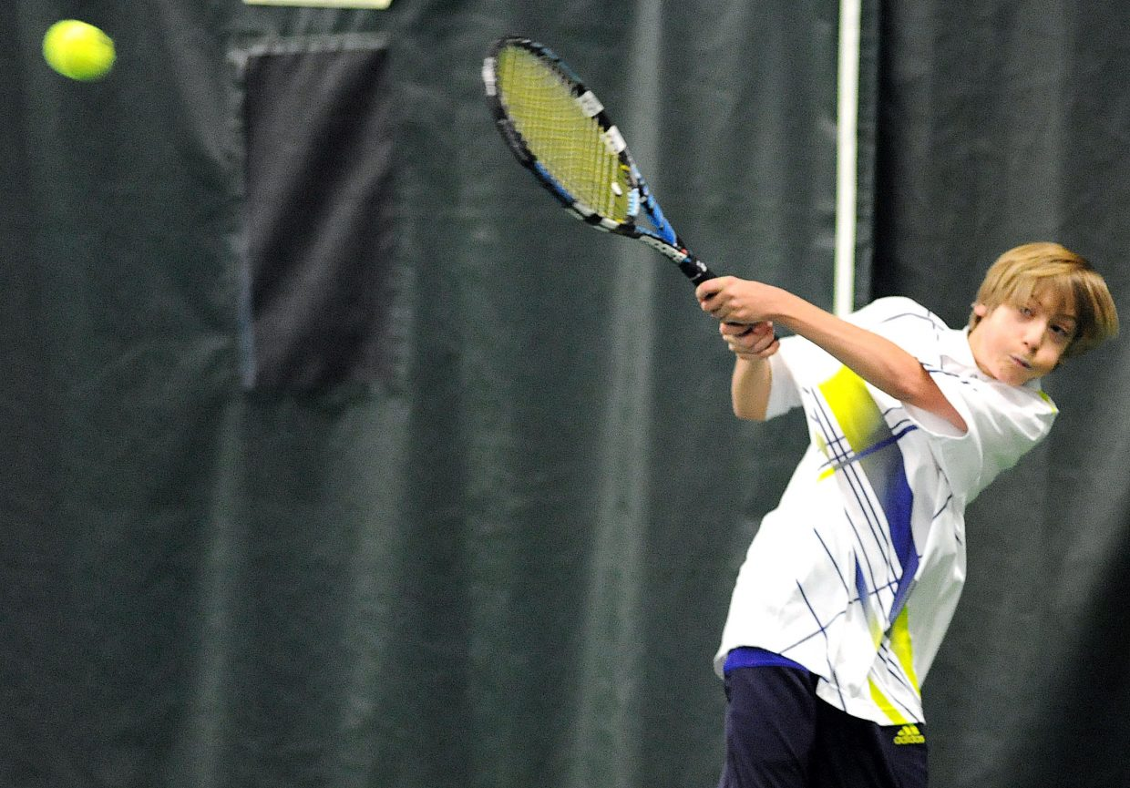 Nick Mathews swings through for a return on Sunday at the Tennis Center.