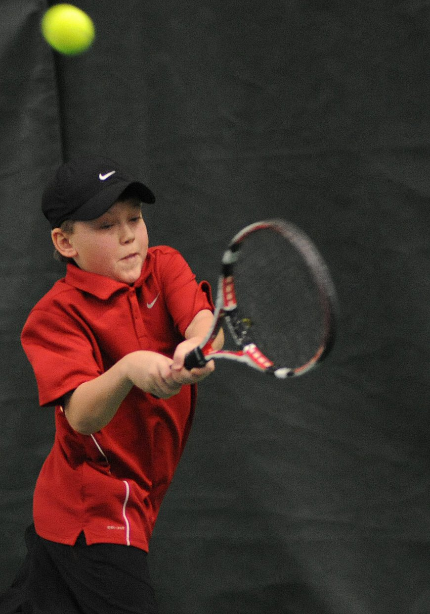 Charlie Smith swings for a ball Sunday in the City Mixed Double and Juniors Championships at the Tennis Center in Steamboat Springs.