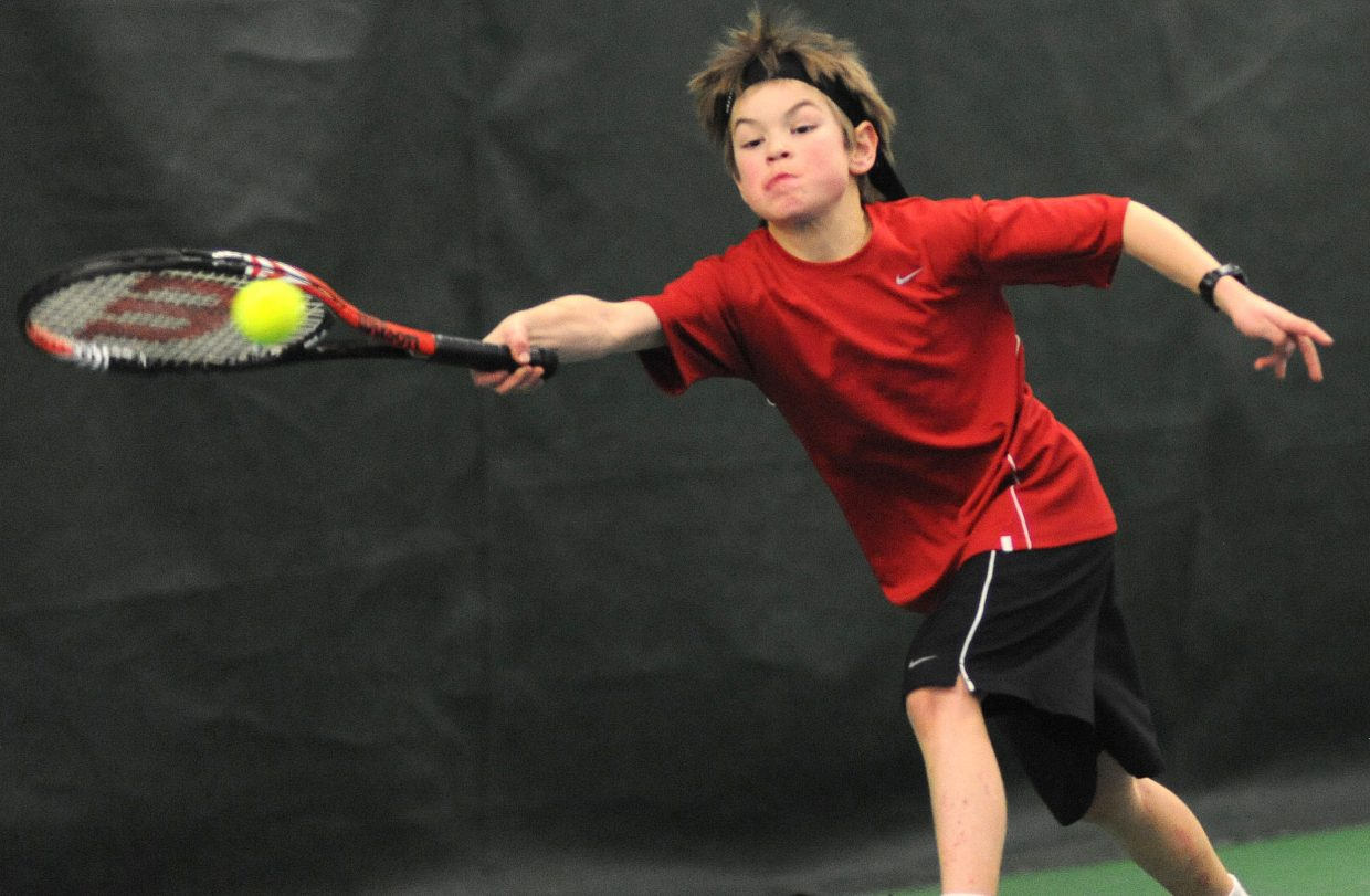 Quinn Snyder plays on Sunday in the City Mixed Double and Juniors Championships at the Tennis Center in Steamboat Springs.