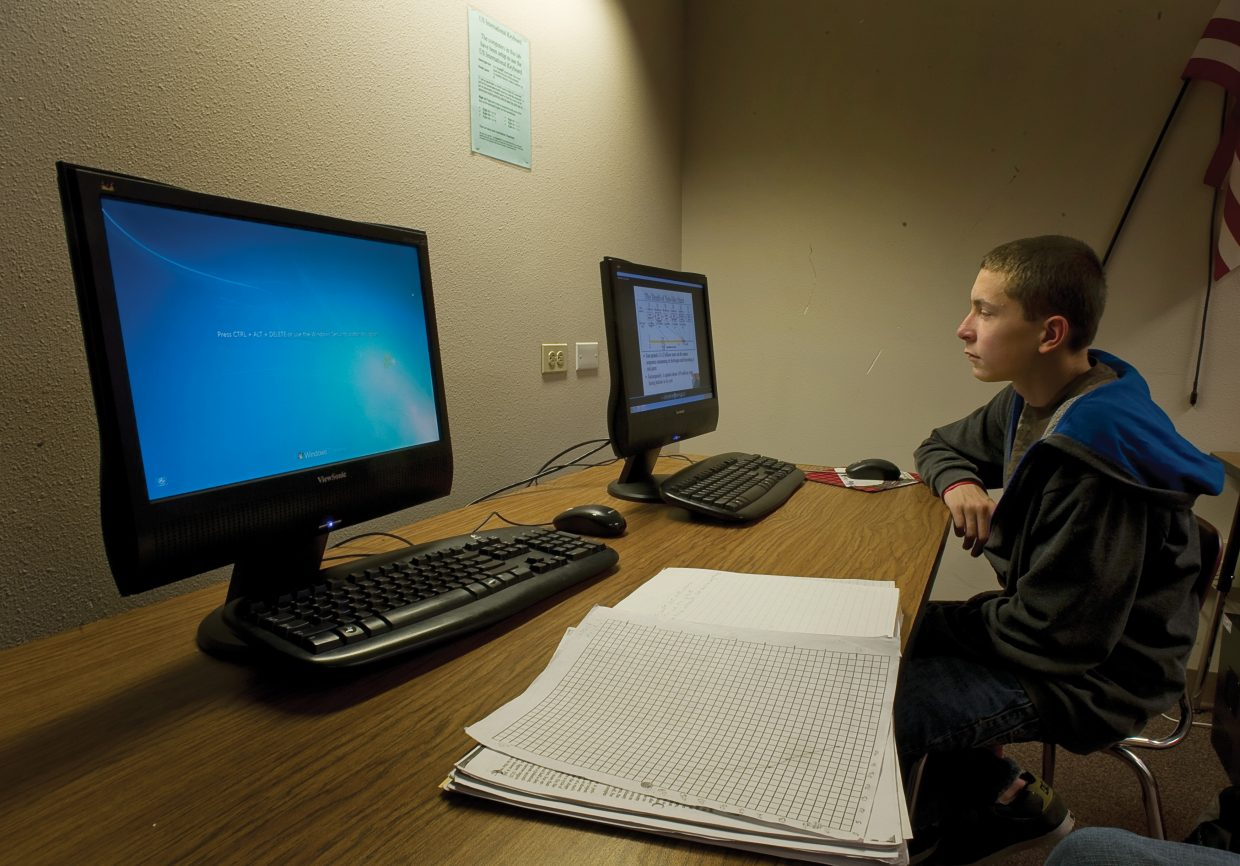 A Steamboat Springs High School student works on a podcast in the computer lab of the high school in 2012.