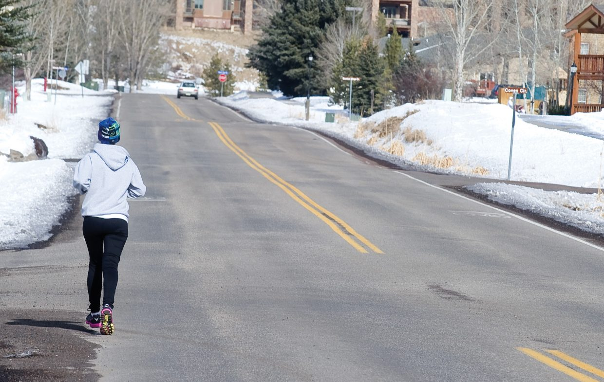Steamboat Springs resident Hannah Hall takes advantage of Monday's warm weather to take a run near Whistler and Walton Creek roads in Steamboat Springs.