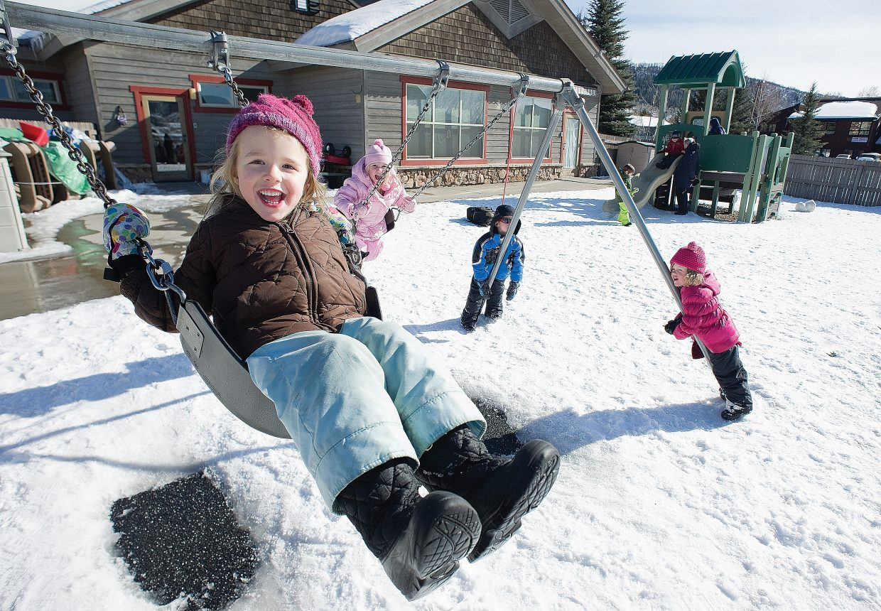 Haley Brabec, a student at the Discovery Learning Center in Steamboat Springs, plays on the swings during recess. A recent report released by the Colorado Center on Law and Policy shows child care costs in Routt County have increased by 35 percent since 2008.
