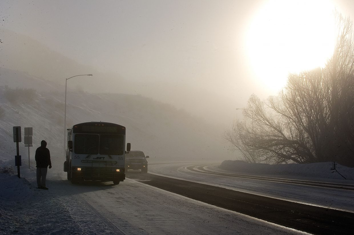 Commuter Chris Hebrank had to wait only a few minutes for his bus to arrive Wednesday morning in Steamboat. Low temperatures in the area closed local schools.