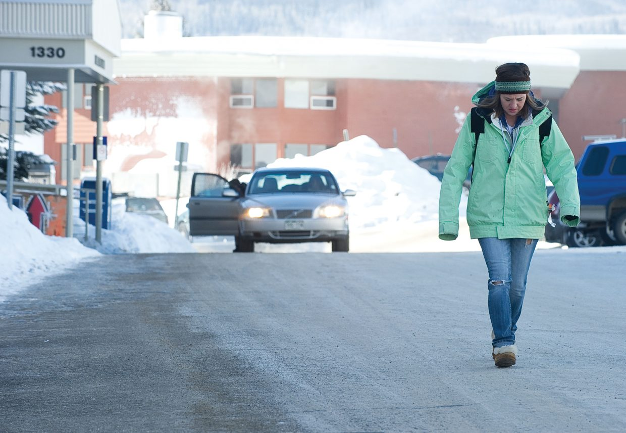 Colorado Mountain College student Teghan Delude walks across the campus between classes Wednesday. The low temperatures may have stopped some classes in Steamboat, but Teghan's classes went on as scheduled.