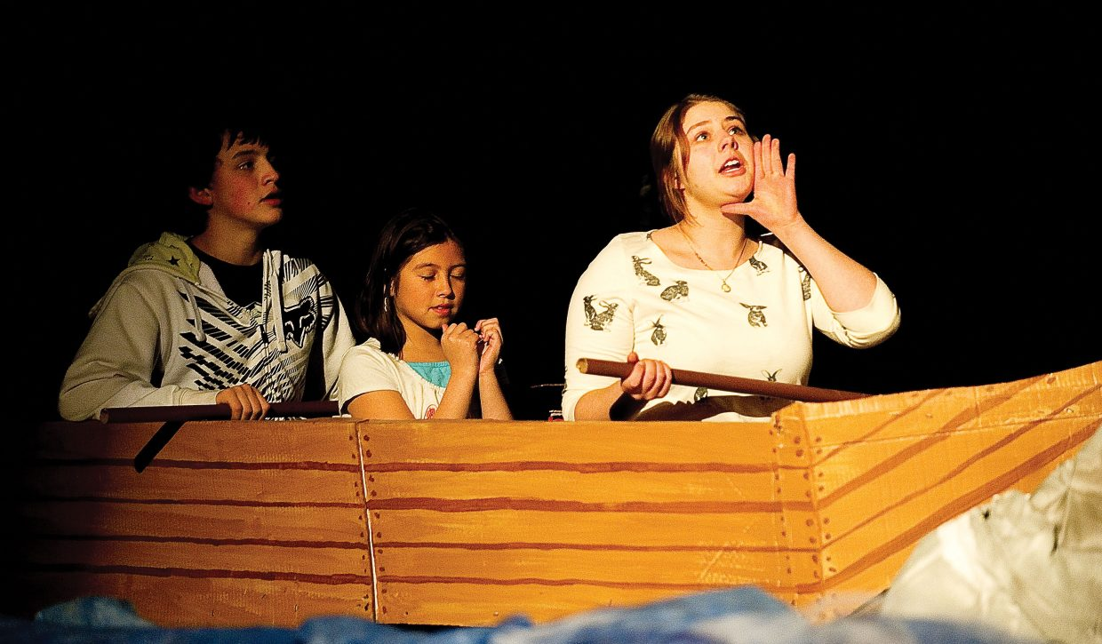 """Smee, played by Ashley Otto, shouts out for Hook while riding in a canoe with Tiger Lily (Brisha Archuleta) and Starkley (Taylor Lewis) in a scene from Class Acts Productions' """"Peter Pan & Wendy."""" Members of the production rehearsed Tuesday night at the Hayden High School auditorium. The play will take center stage at 7 p.m. Friday."""