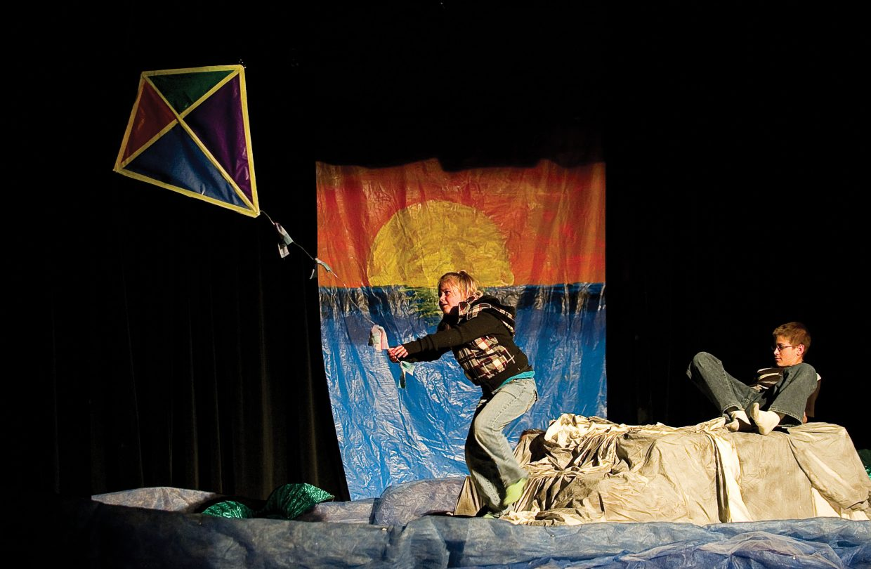 Wendy, played by Alli Ingols-Irwin, grabs a kite in an effort to escape the rising waters while rehearsing a scene from Class Acts Productions Peter Pan at the Hayden High School Auditorium Tuesday evening. Peter Pan, played by William Lighthizer joined Ingols-Irwin in the scene.
