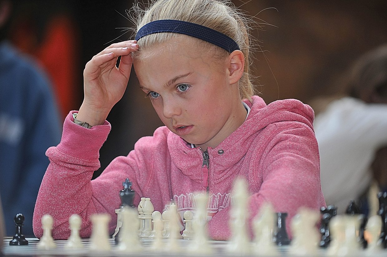 Strawberry Park Elementary School fifth-grader Riley Smith contemplates her next move Friday afternoon during a chess tournament at the school. The chess club hosts events on Tuesdays and Thursdays and is very popular with students. On Friday, organizers hosted a tournament at the school in which students tested the skills they have learned against their fellow classmates.