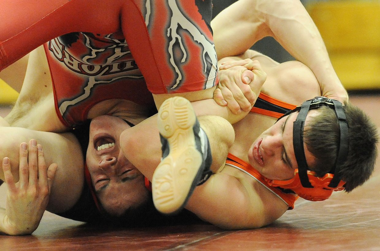 Steamboat's Casey Williams and Hayden's Taylor Lewis wrestle Thursday. The pain was short-lived for Williams, who won the match.