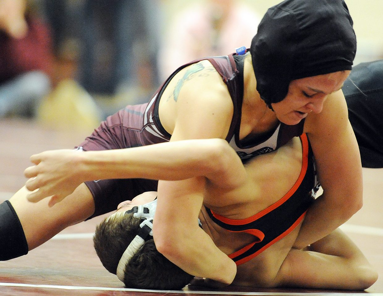 Soroco's Lauryn Bruggink pushes for the pin against Hayden's Tanner Guire on Thursday.