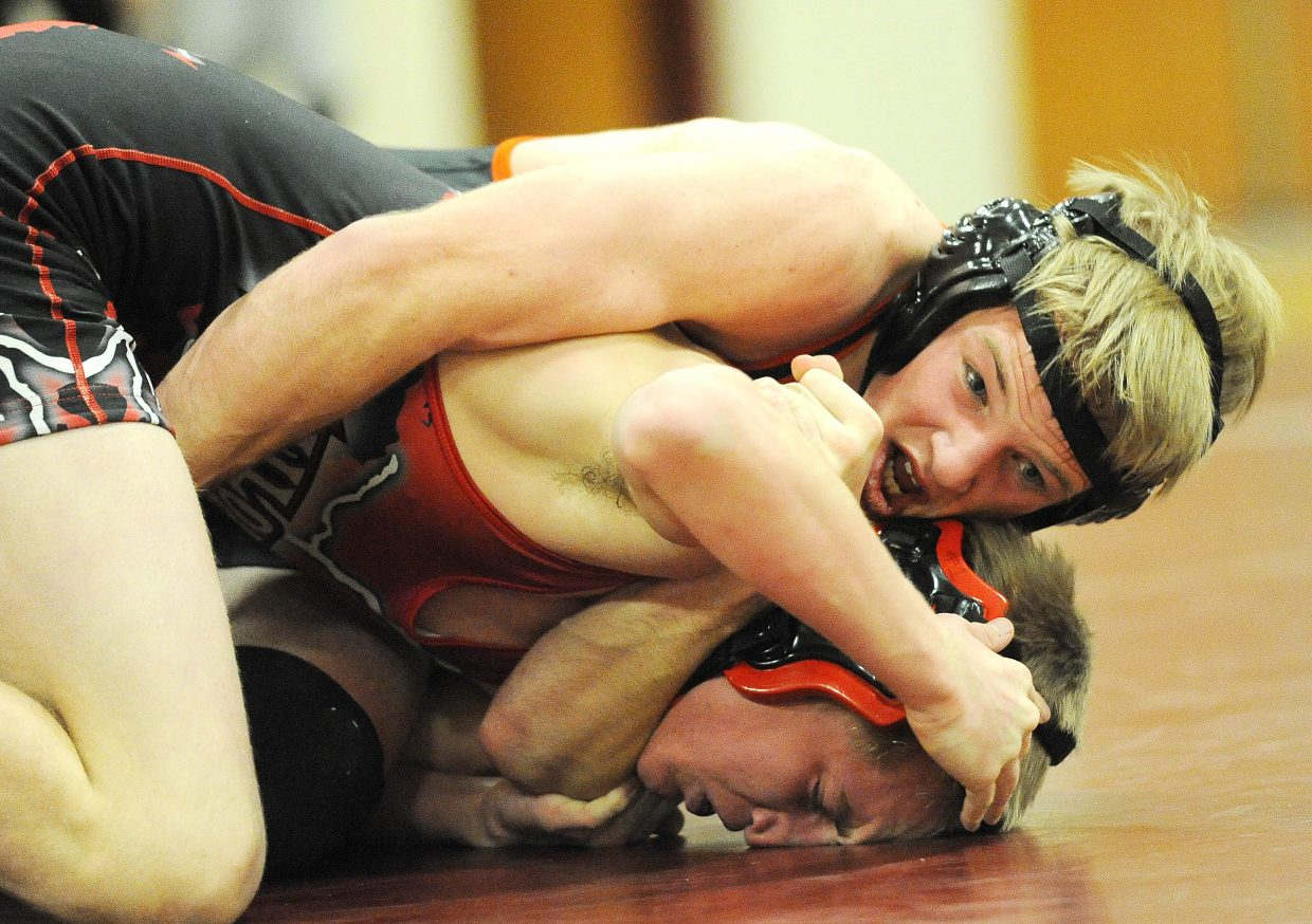 Hayden's Nick Williams clamps down on Steamboat's Logan Epperson on Thursday.