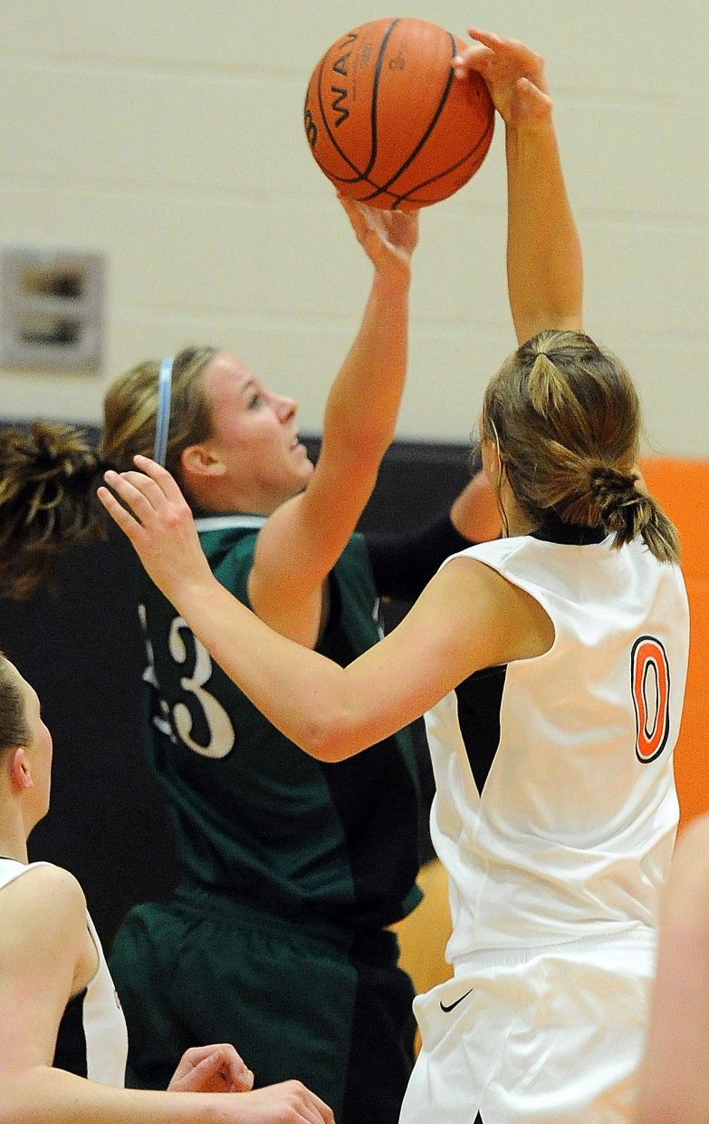 Hayden's Erin Koehler blocks a shot Friday against Pleateau Valley. She finished with 32 points and 13 rebounds.