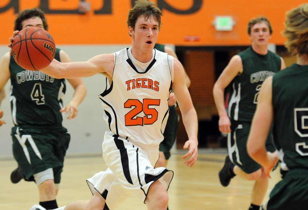 Hayden's Mark Doolin drives down the court Friday against Plateau Valley.