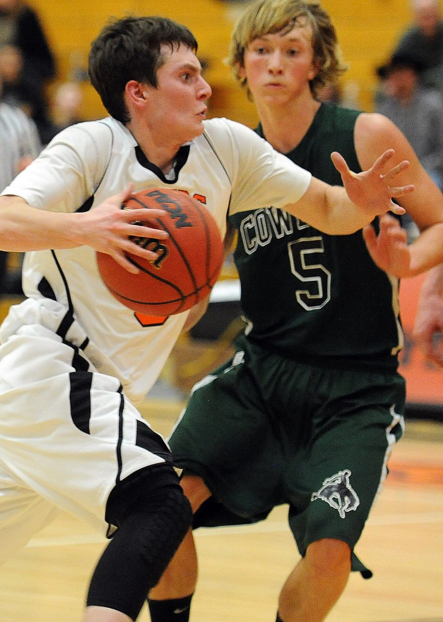 Hayden's Paul Laliberte drives to the basket on Friday against Plateau Valley.