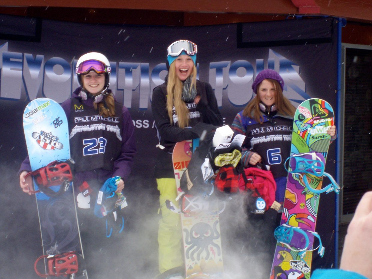 Haille Soderholm stands atop the women's half-pipe podium at the Revolution Tour in Ostego, Mich. Kirby Kelly, right, placed second.