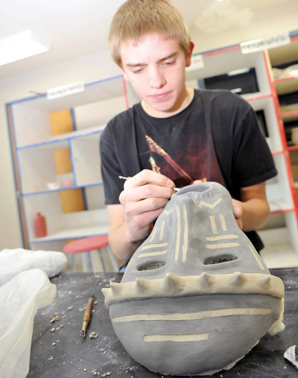 Freshman Andrew Sabia works on a mask project Wednesday during an art class at Steamboat Springs High School. A memorial fund recently established for the late Jack Finney through the Yampa Valley Community Foundation will grant some funds to the high school to help build a permanent art display in the lobby.
