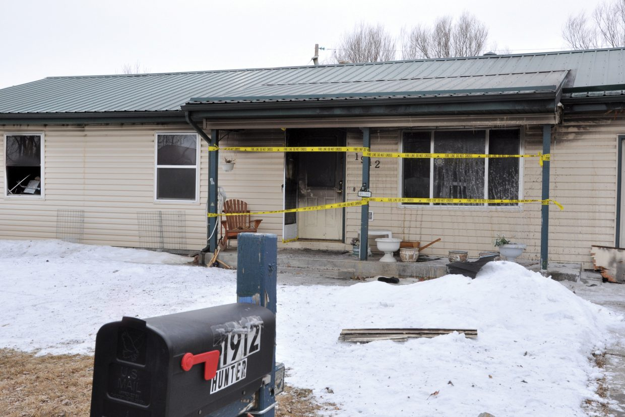 The home of Ursula and Patrick Hunter, 1912 Woodland Ave., Craig, was taped off Wednesday morning after a fire at the house Tuesday evening. Ursula Hunter died in the fire.