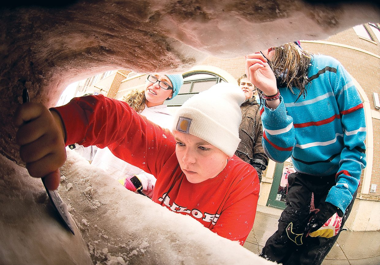 Katy Jones, a junior at Steamboat Springs High School, works on a snow sculpture, for the Winter Carnival tradition in Steamboat. Learn how to create one at the Snow Glow snow carving instruction workshop hosted by Steamboat Creates and Steamboat Springs Arts Council on Tuesday.