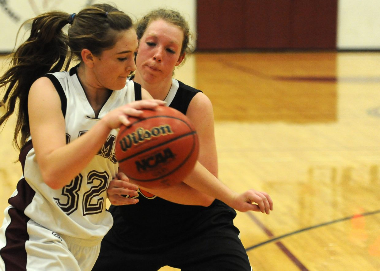 Soroco's Jacey Schlegel tries to drive to the basket against Hayden's Aubree Haskins on Friday in Oak Creek.