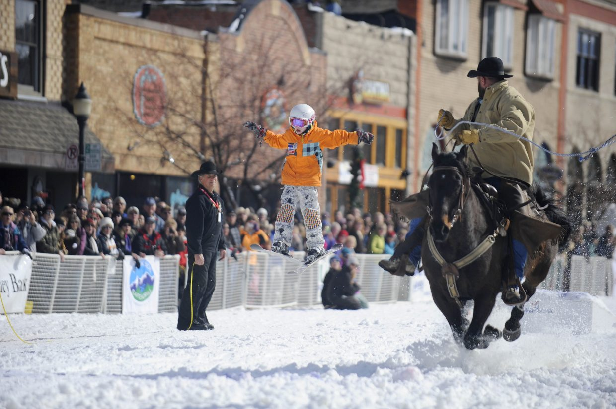 Liam Baxter competes in the donkey jump competition during the Winter Carnival street events Saturday.