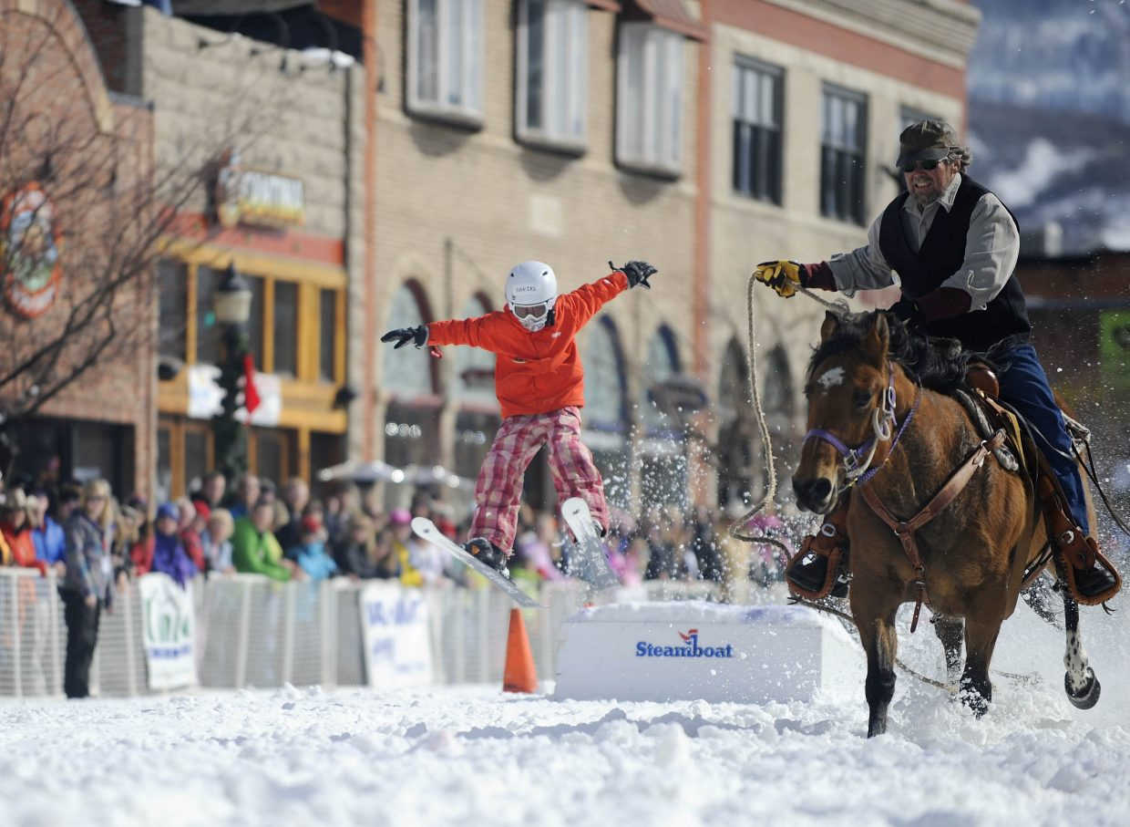 Annika Belshaw competes in the donkey jump competition during the Winter Carnival street events Saturday.